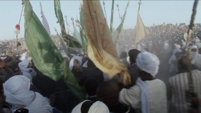 Yazid Ben Hounet, Mawlid, Préparation et échange des drapeaux à Sid el Hadj Belqacem